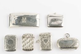 An Edwardian silver sovereign and stamp case, with foliate engraved decoration, by William