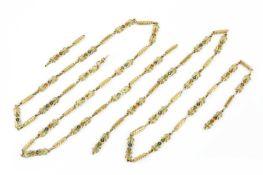 A 19th century Swiss enamel long chain, designed as a line of shaped rectangular panels, alternately