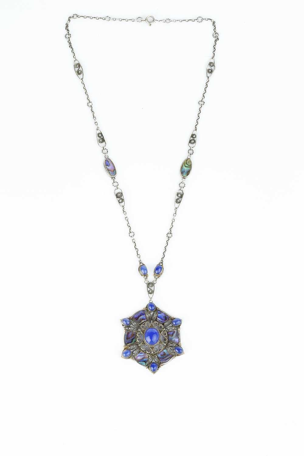 An Arts and Crafts pendant necklace, the openwork pendant designed as a cluster of oval blue stained - Image 3 of 3