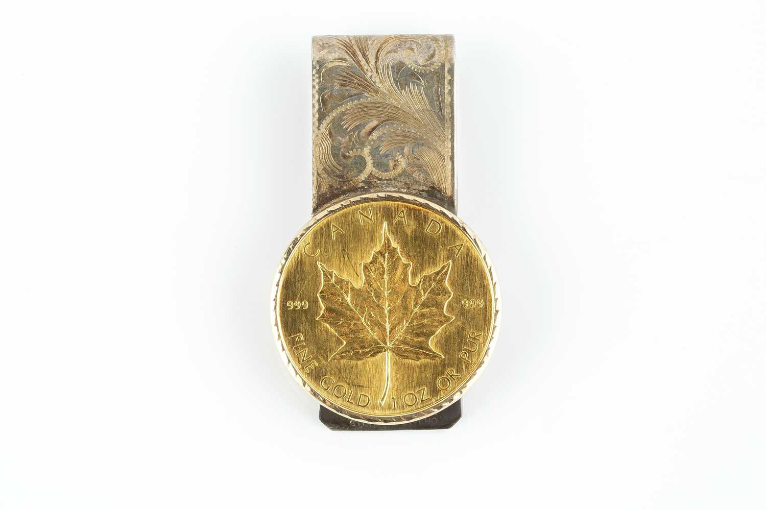 A Canada 50 Dollars, dated 1980, in fixed bi-colour money clip mount, engraved with foliate