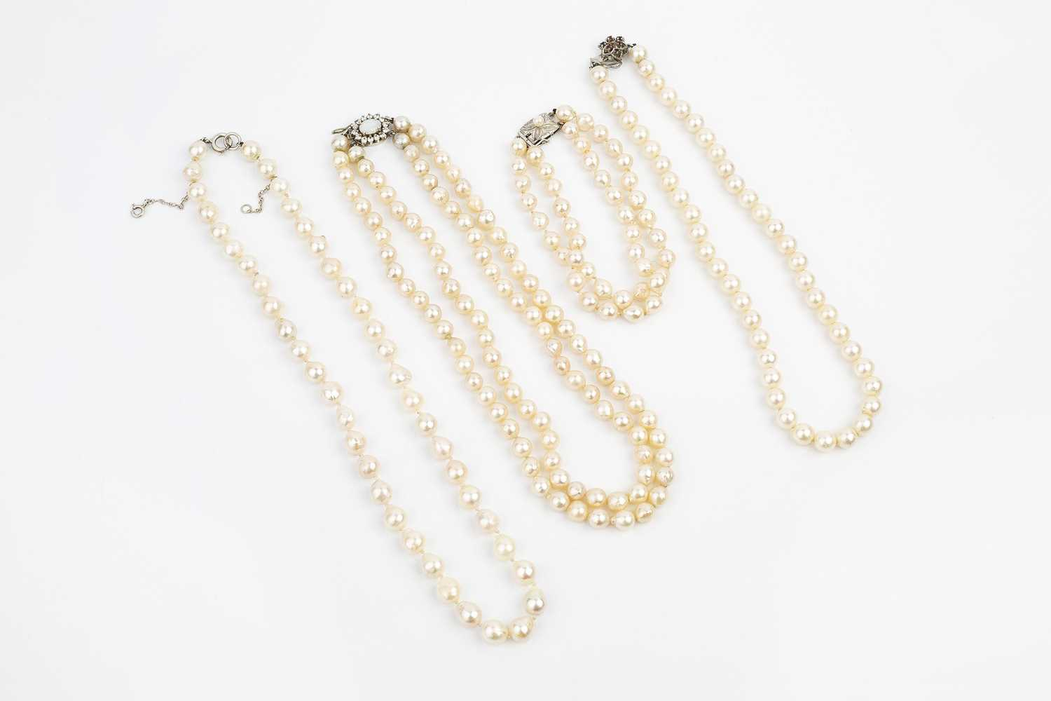 A collection of cultured pearl jewellery, comprising a double strand collar necklace, with an oval