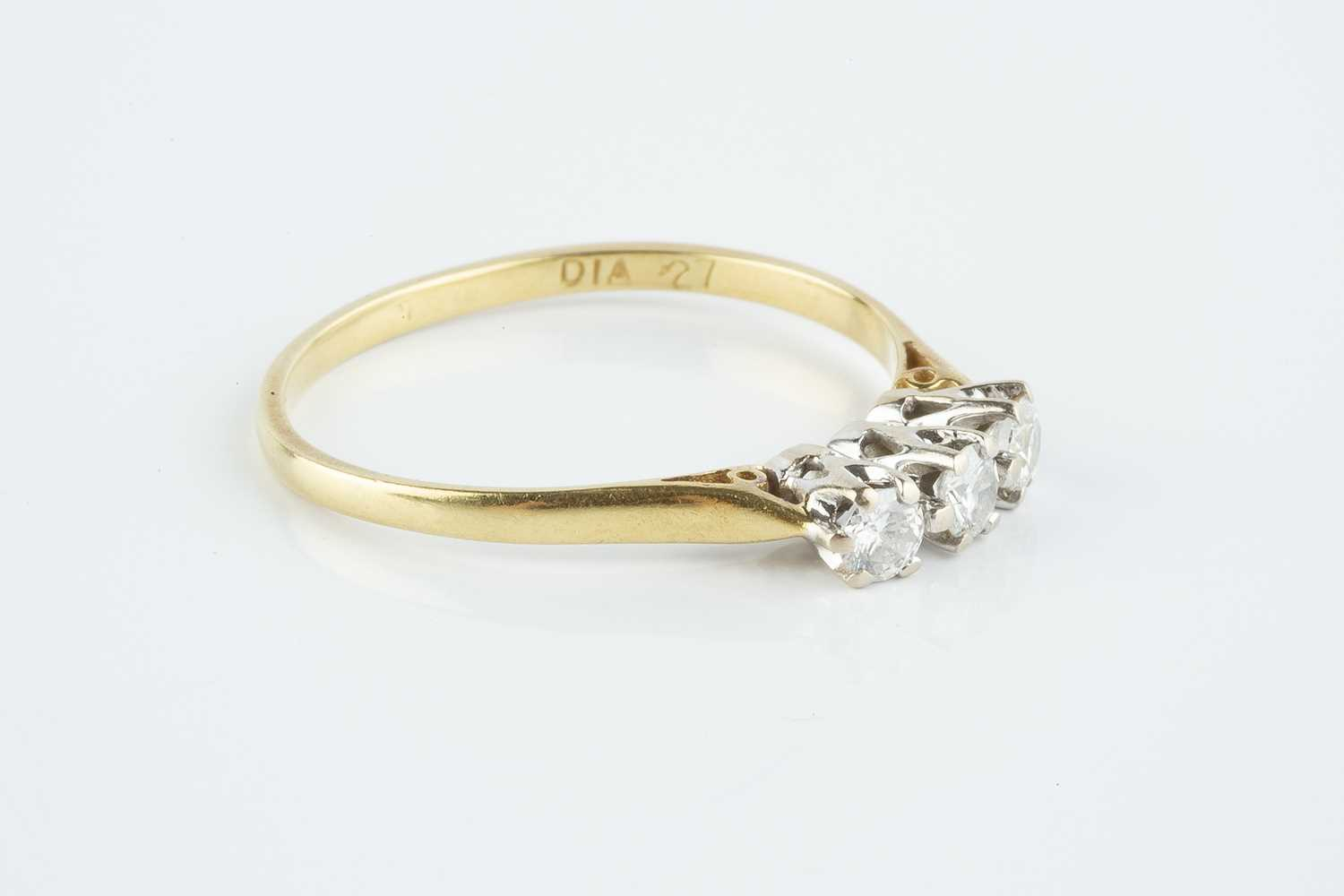 A diamond three stone ring, the round brilliant-cut diamonds in claw setting, 18ct gold mounted, - Image 2 of 3