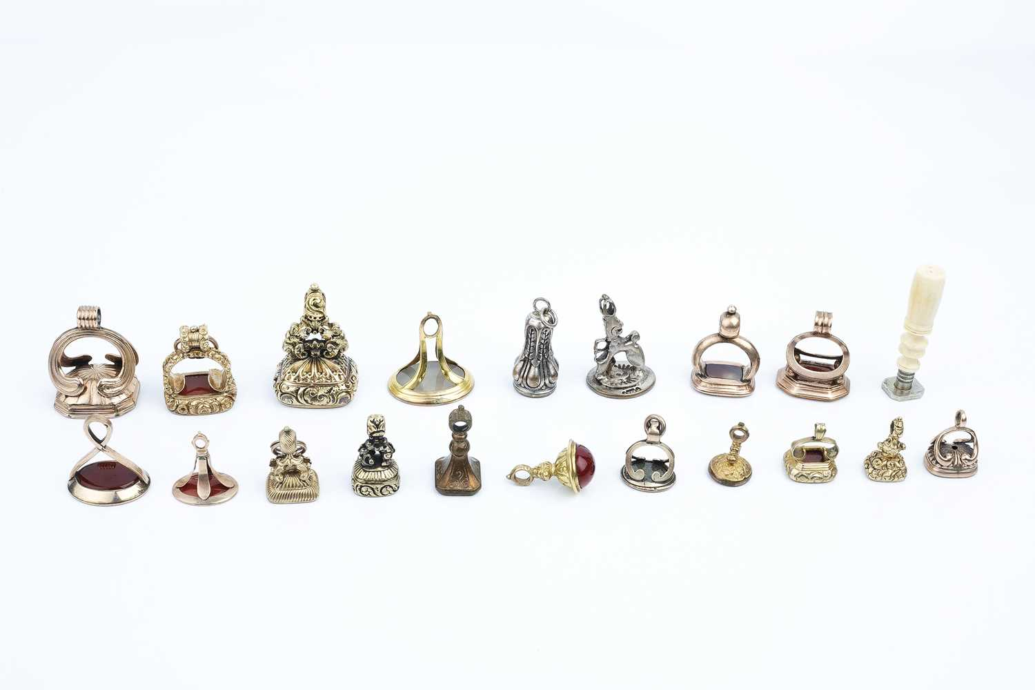 A collection of antique and later seal fobs, variously inset with hardstone and paste intaglios, - Image 2 of 2