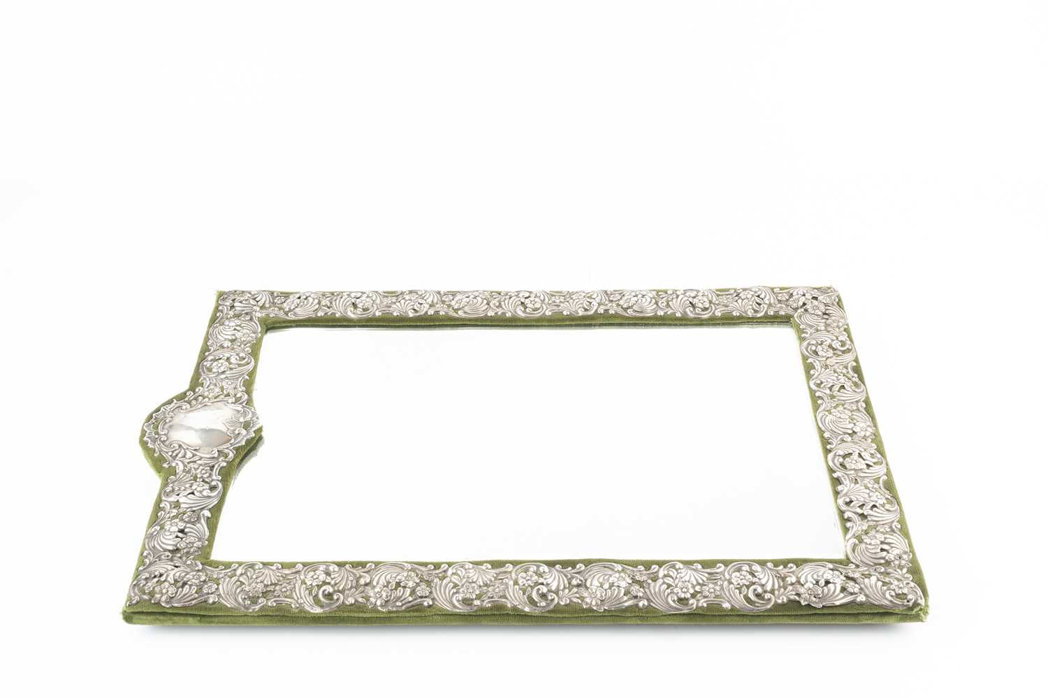A late Victorian silver mounted easel dressing table mirror, pierced and embossed with repeated