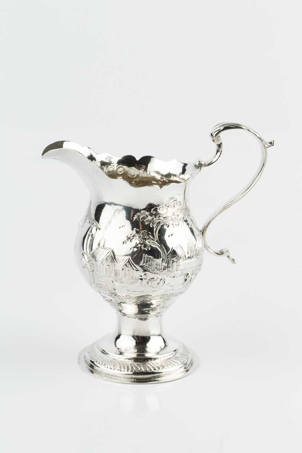 A George III silver cream jug, with baluster body embossed and engraved with a continuous village - Image 3 of 3
