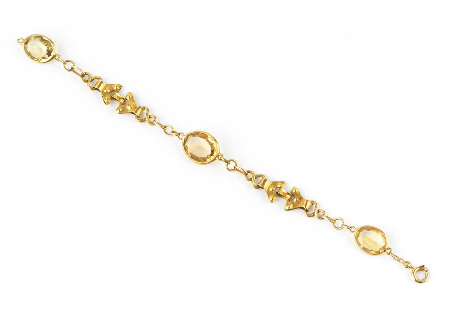 A citrine set panel bracelet, of fancy-link design, the trio of oval mixed-cut citrines in collet