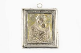 A Greek orthodox silver cased icon, depicting the Madonna and child, with printed faces, on wood