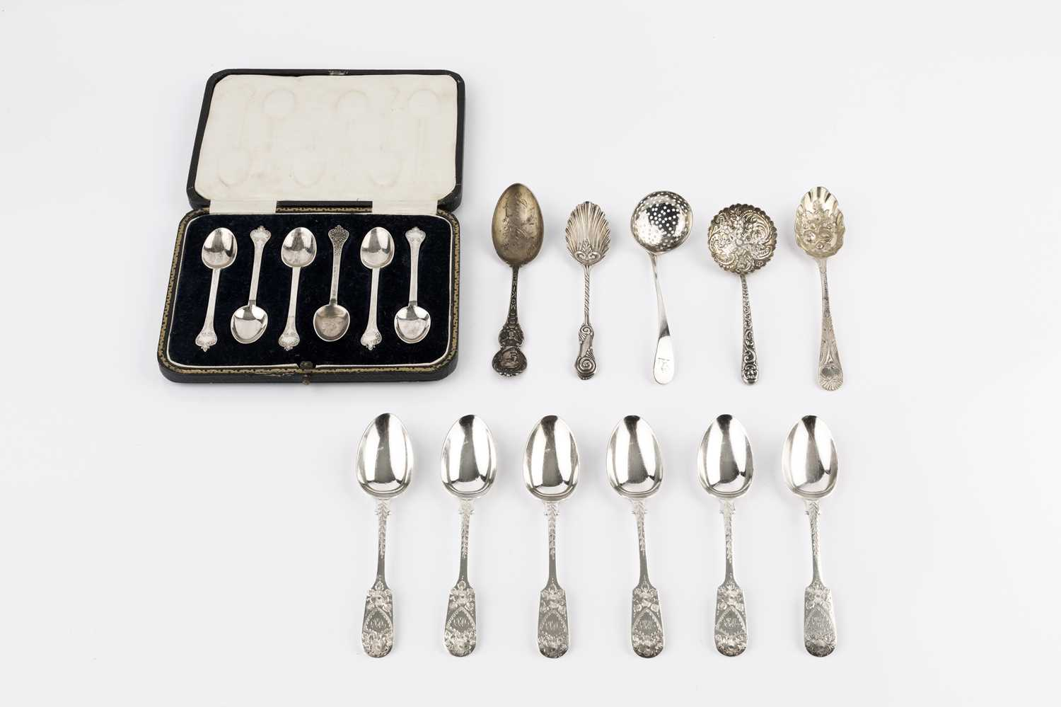 A set of six silver coffee spoons, with shaped and scroll decorated terminals by Thomas Bradbury &