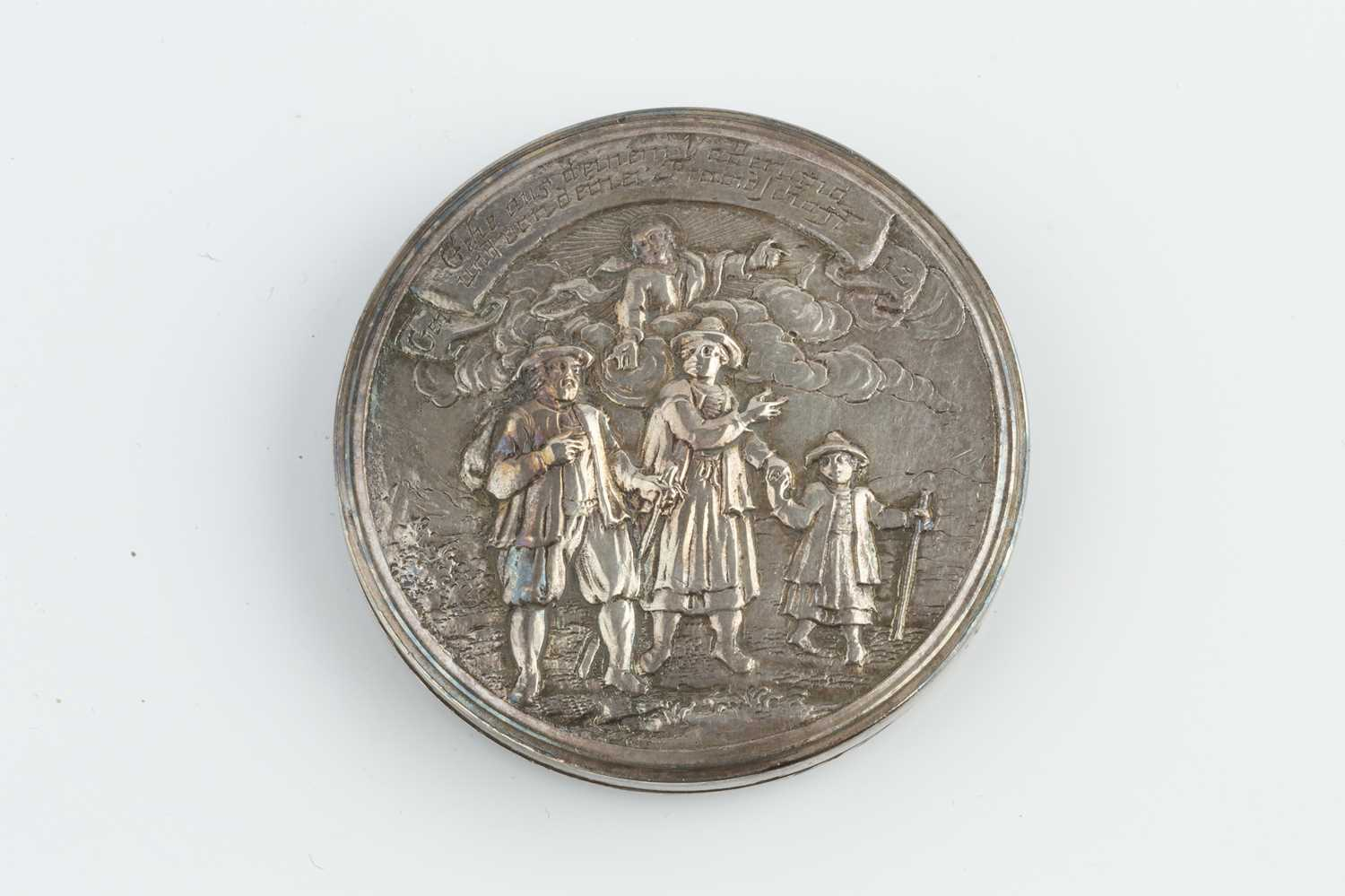 An 18th/19th century silver circular box, relief decorated to both sides with figures and - Image 2 of 4