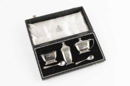 A silver three piece cruet set, by Garrard & Co, Birmingham 1958, cased; a set of six silver