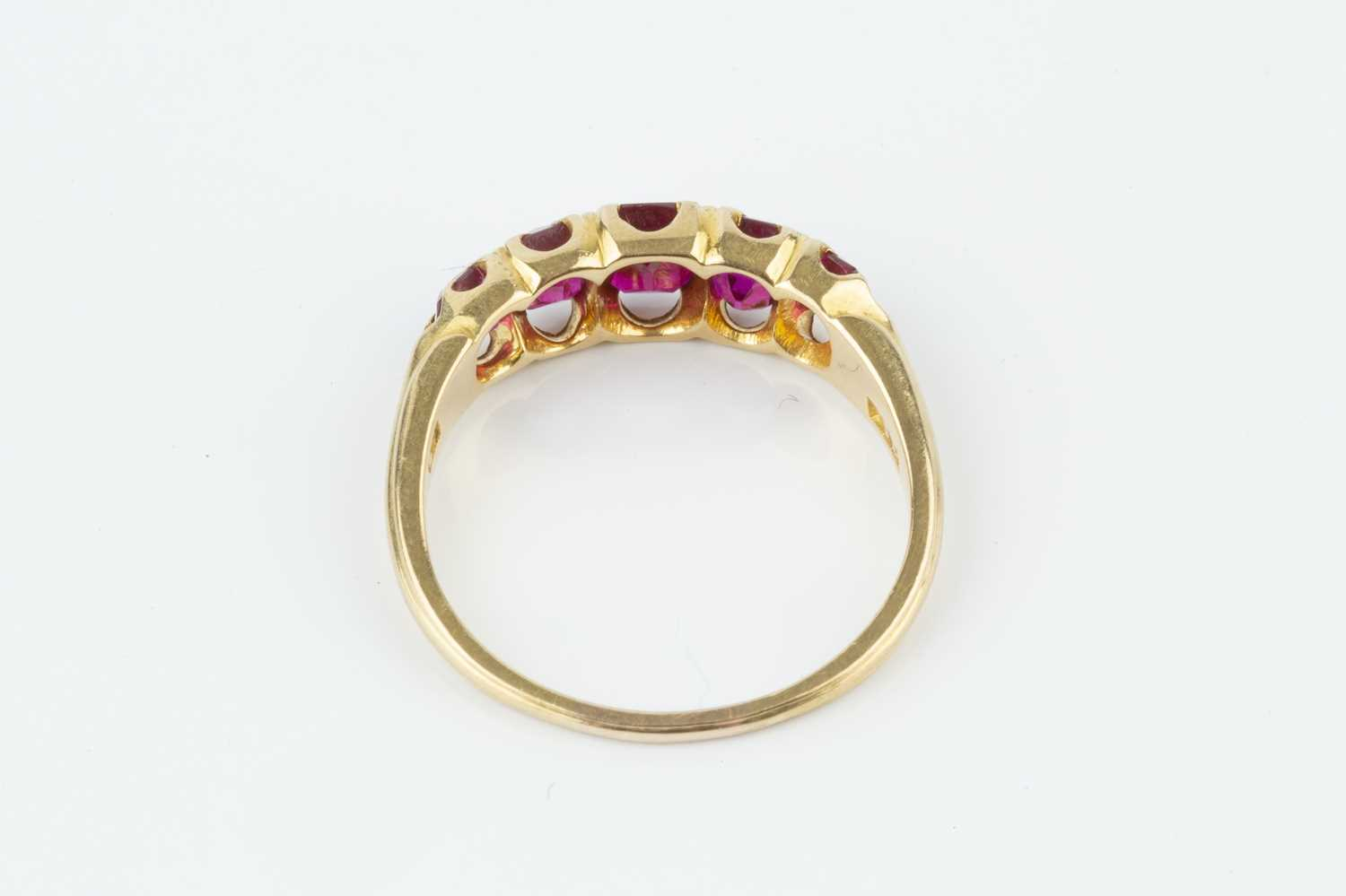 A ruby five stone ring, the graduated cushion-shaped mixed-cut rubies in fancy claw setting, - Image 3 of 3