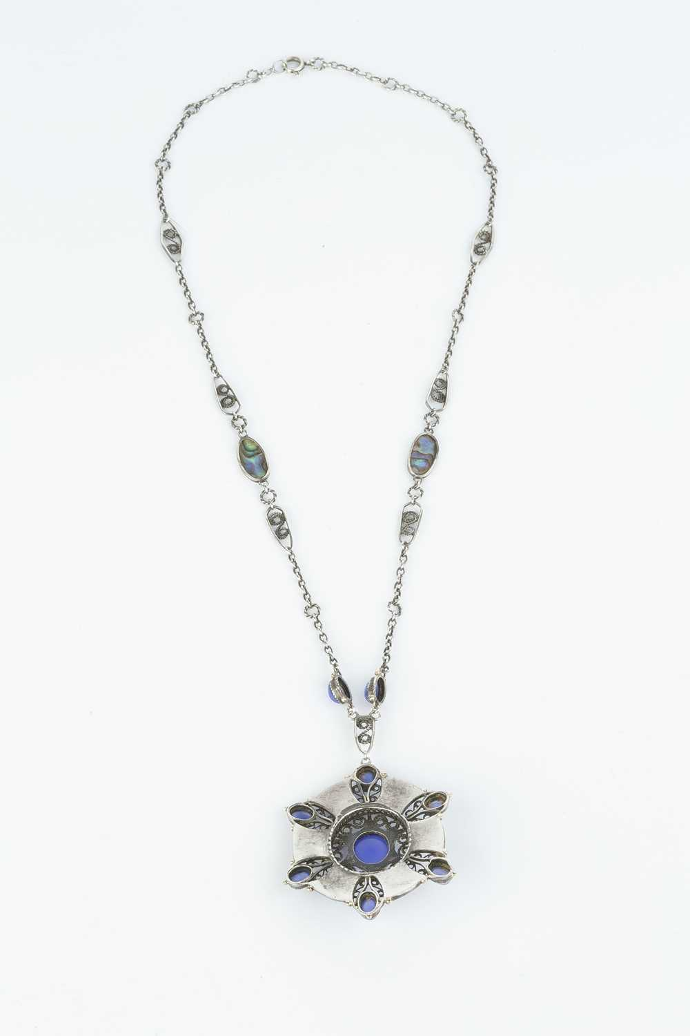 An Arts and Crafts pendant necklace, the openwork pendant designed as a cluster of oval blue stained - Image 2 of 3