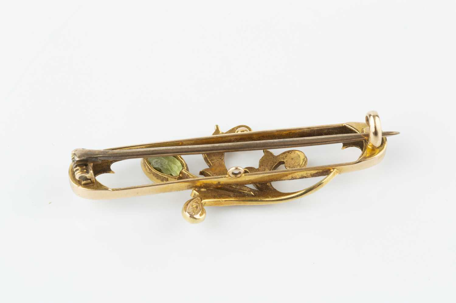 A peridot and half pearl panel brooch, the elongated oval openwork panel applied with a foliate - Image 3 of 3