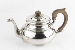A silver teapot, with raised stylised leaf decoration to the lid and spout, and having composition