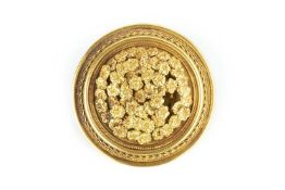 A 19th century 'millefiori' brooch, in the manner of Castellani, the circular panel centred with a