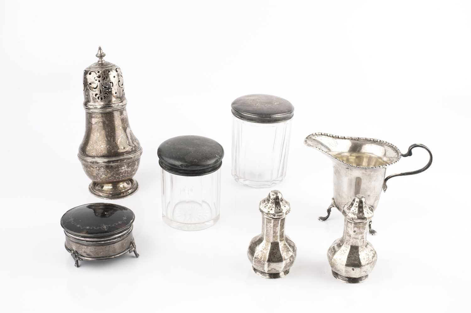 A collection of silver, comprising a circular trinket box with tortoiseshell and piqué inset