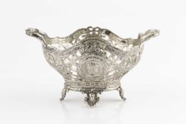 A Continental late 19th century silver twin handled small basket, the trellis pierced sides