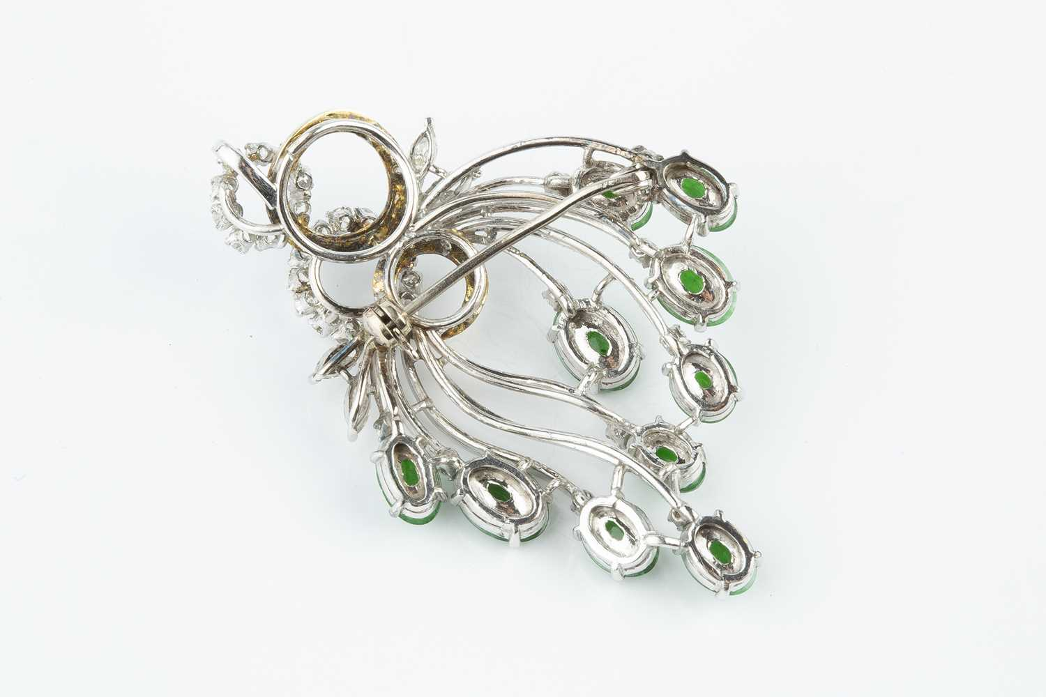 A jade and diamond spray brooch/pendant, designed as a tiered wirework spray of oval jade - Image 2 of 2