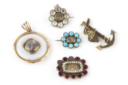 A collection of 19th century memorial jewellery, comprising a garnet, half pearl and hairwork