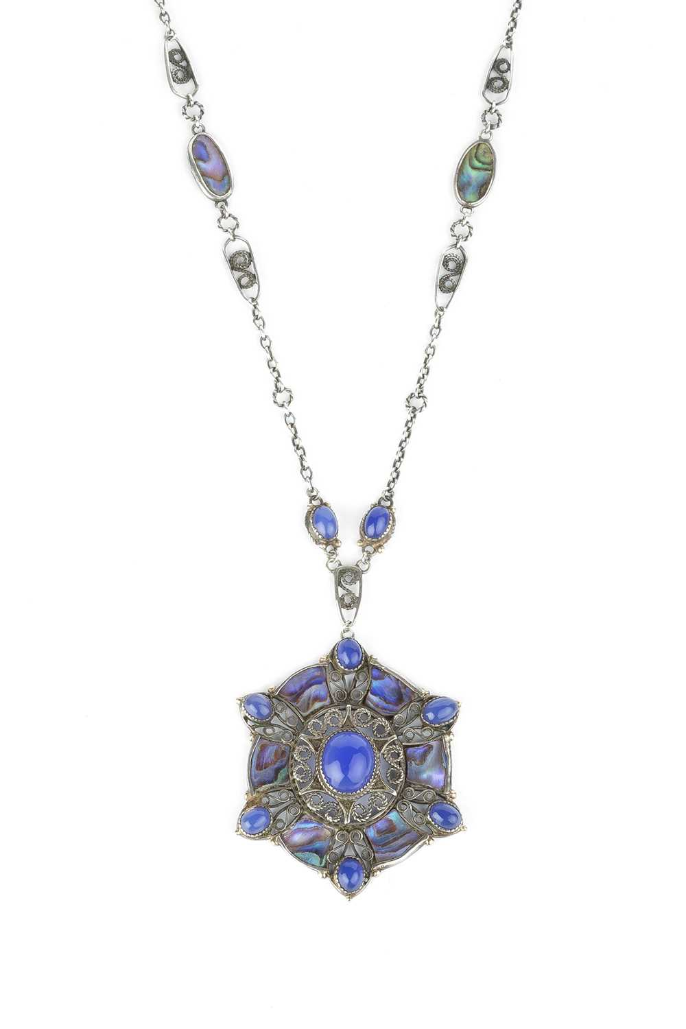 An Arts and Crafts pendant necklace, the openwork pendant designed as a cluster of oval blue stained