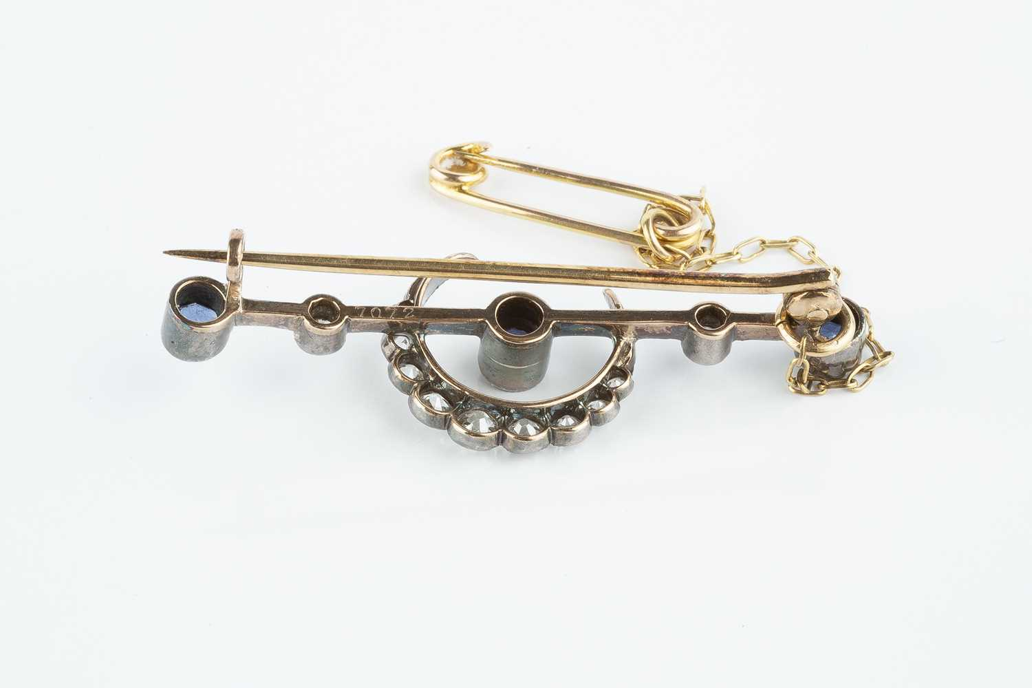 A late Victorian/Edwardian sapphire and diamond crescent bar brooch, the knife edge bar centred with - Image 2 of 2