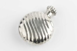 A late Victorian silver scent bottle, of fluted circular flask form, with lobed screw cover, by