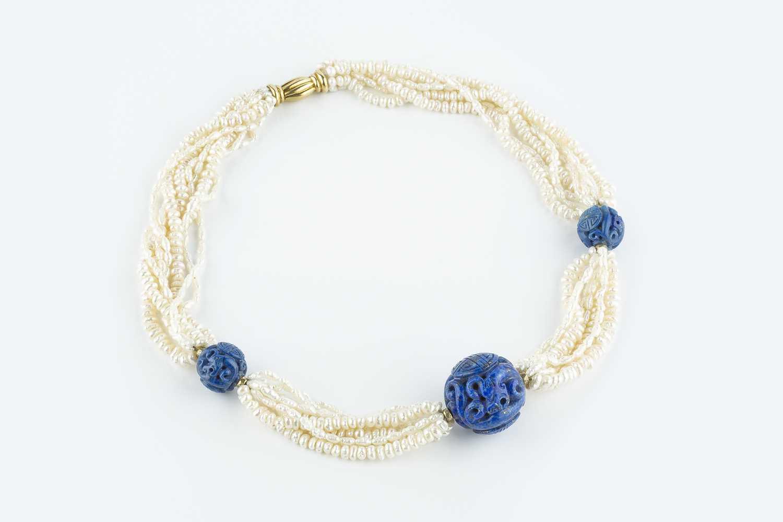 A freshwater pearl torsade and lapis lazuli bead necklace, the freshwater pearl torsade spaced by