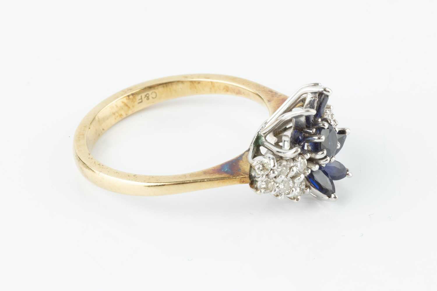 A sapphire and diamond cluster ring, designed as an abstract spray of circular mixed-cut and - Image 2 of 3