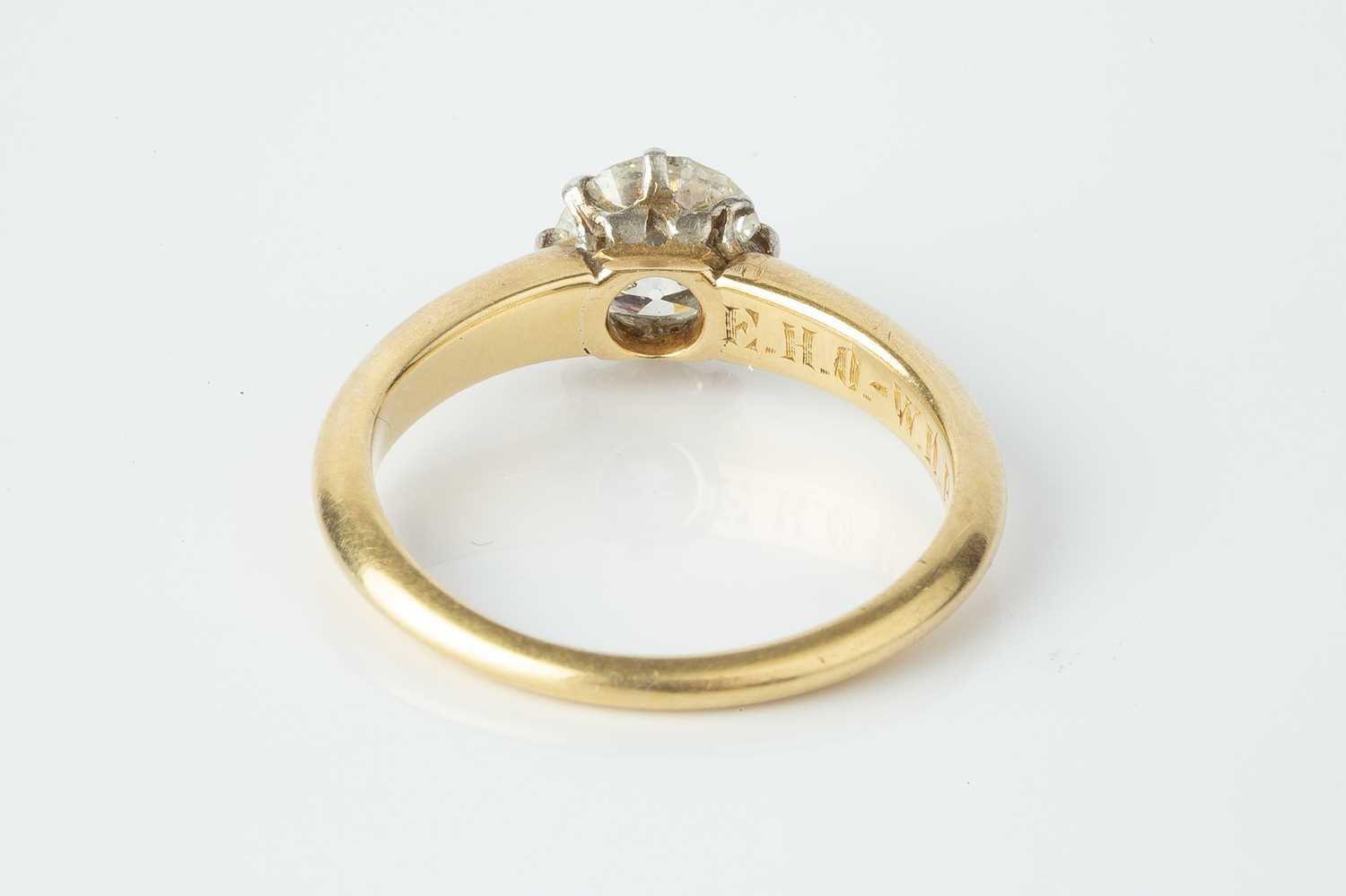 A diamond single stone ring, the old brilliant-cut diamond in claw setting, stamped '18ct', with - Image 2 of 2