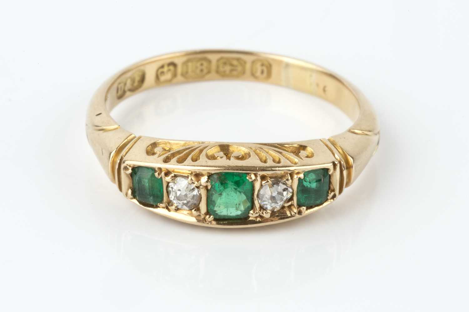 A late Victorian emerald and diamond five stone ring, alternately set with graduated rectangular