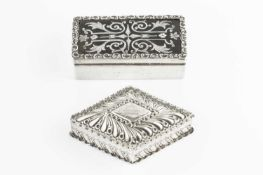 A late Victorian silver lozenge shaped box and cover, with punched and embossed decoration by