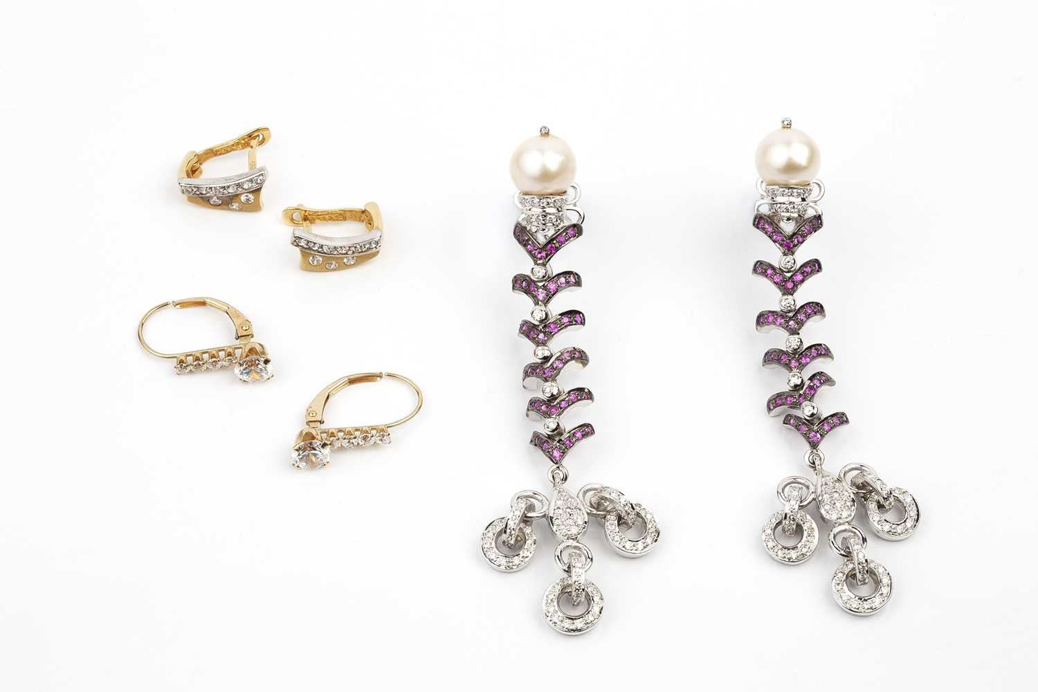 A pair of cultured pearl, diamond and gem set ear pendants, of articulated design, with wishbone-