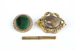 A collection of brooches, comprising a malachite and half pearl panel brooch, of circular design, (