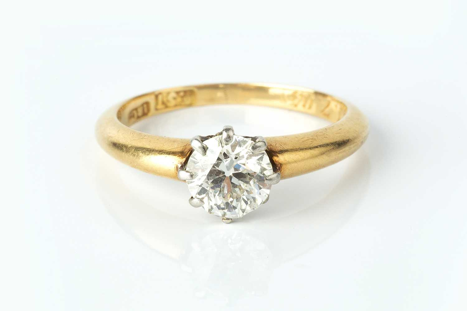 A diamond single stone ring, the old brilliant-cut diamond in claw setting, stamped '18ct', with