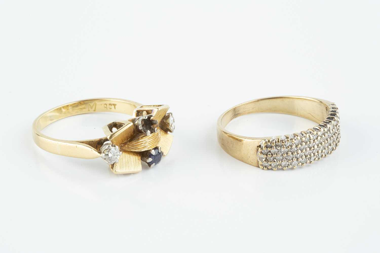 A sapphire and diamond dress ring, highlighted with a circular mixed-cut sapphire and two round - Image 2 of 3