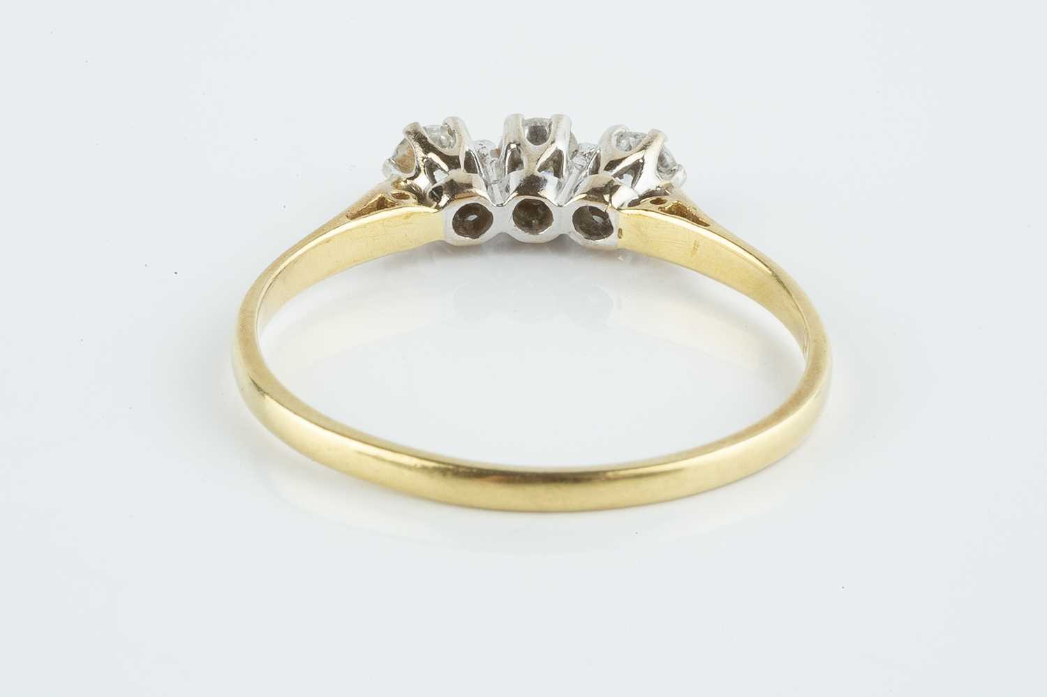 A diamond three stone ring, the round brilliant-cut diamonds in claw setting, 18ct gold mounted, - Image 3 of 3