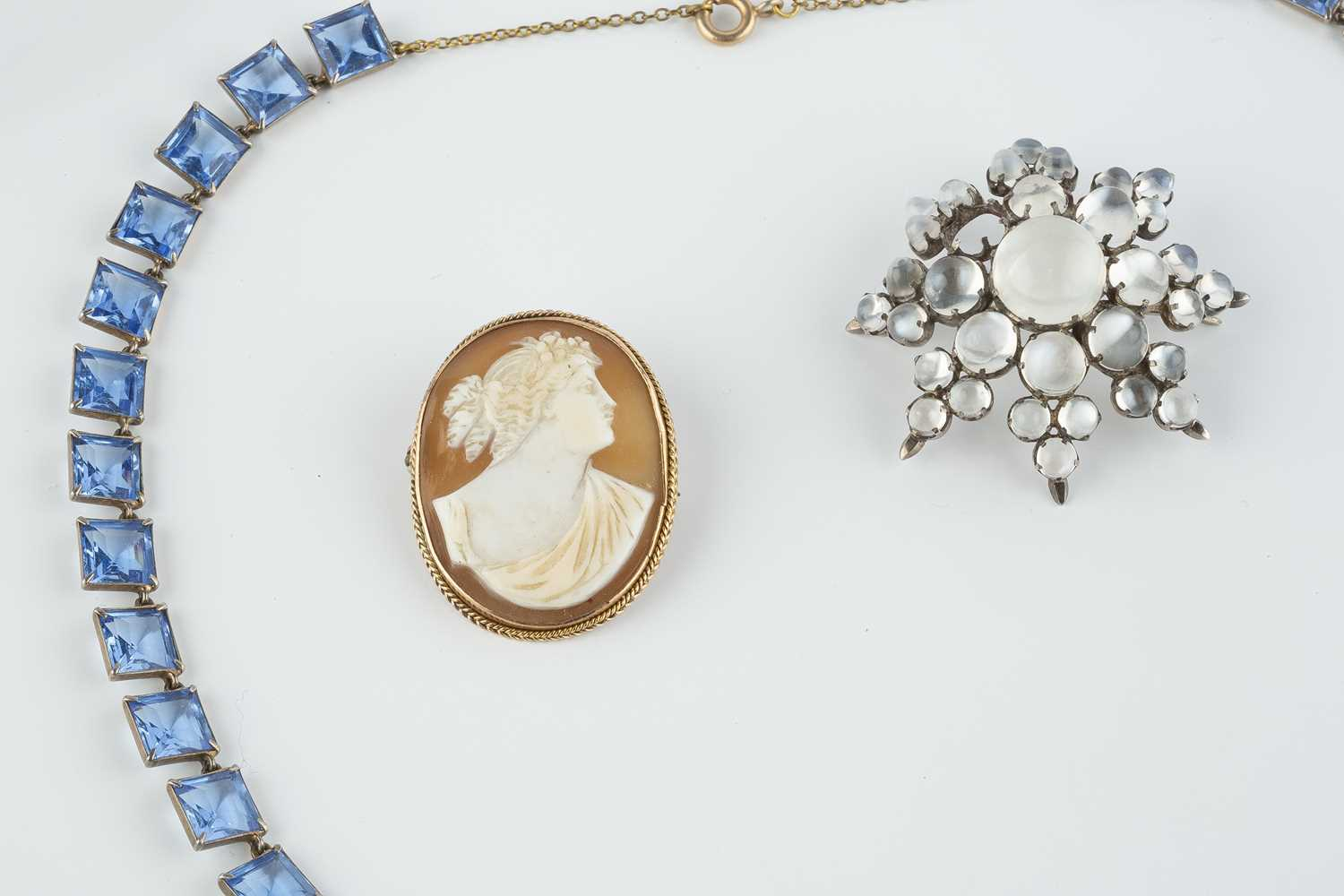 A collection of jewellery, comprising a moonstone star brooch, (one cabochon deficient), an oval - Image 2 of 3