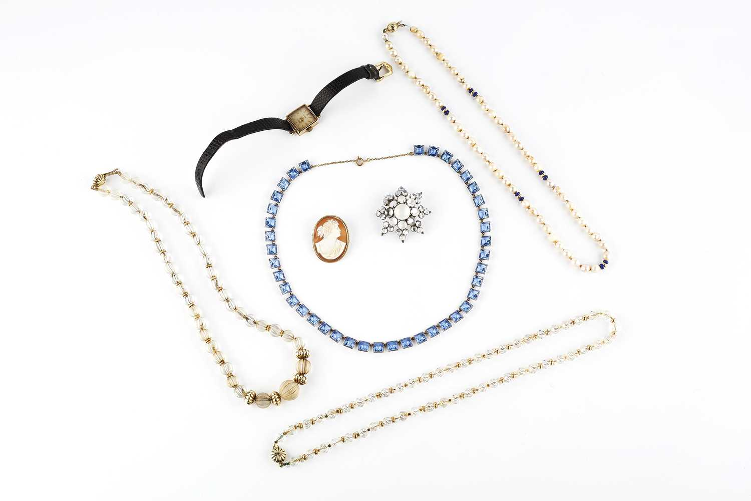 A collection of jewellery, comprising a moonstone star brooch, (one cabochon deficient), an oval