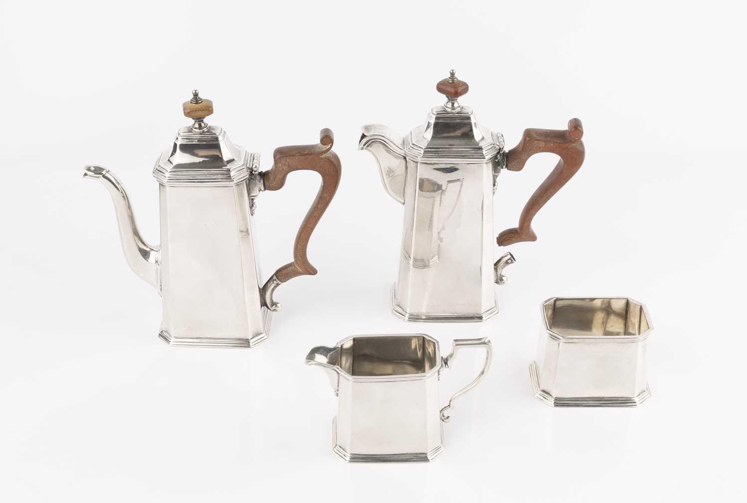 A silver four piece bachelor's coffee service, of chamfered and tapered rectangular form, the coffee