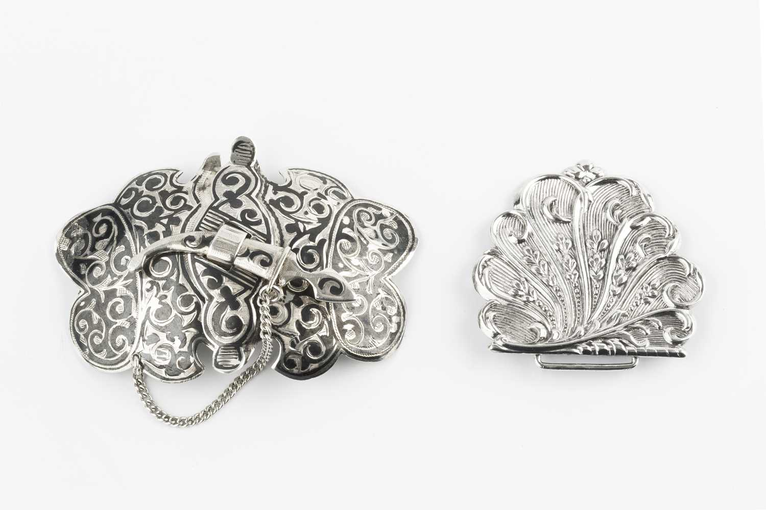 A Russian silver and niello two piece belt buckle, of shaped outline, with seimitar clasp, 8cm wide;
