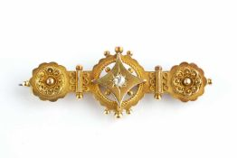 A late Victorian diamond set panel brooch, centred with an old-cut diamond set lozenge, with