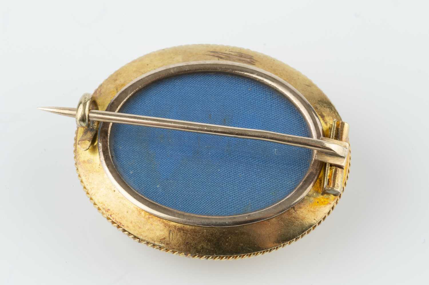A Victorian panel brooch, the convex oval panel applied with a floral spray to a textured ground, - Image 2 of 2