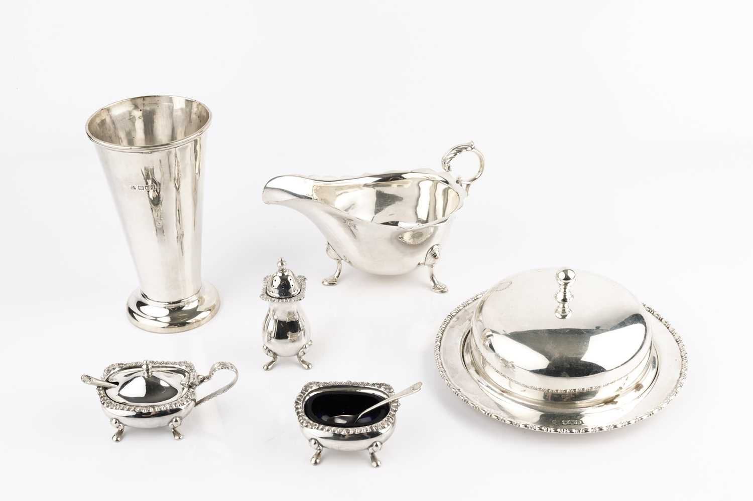 A silver sauce boat, with scroll handle by Horace Woodward & Co, Birmingham 1919, a silver