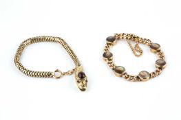 A serpent bracelet, the head with cabochon garnet highlight, faceted red stone eyes and foliate