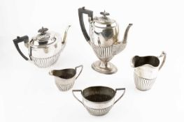 A silver four piece tea and coffee service, with half lobed decoration, the tea and coffee pots with