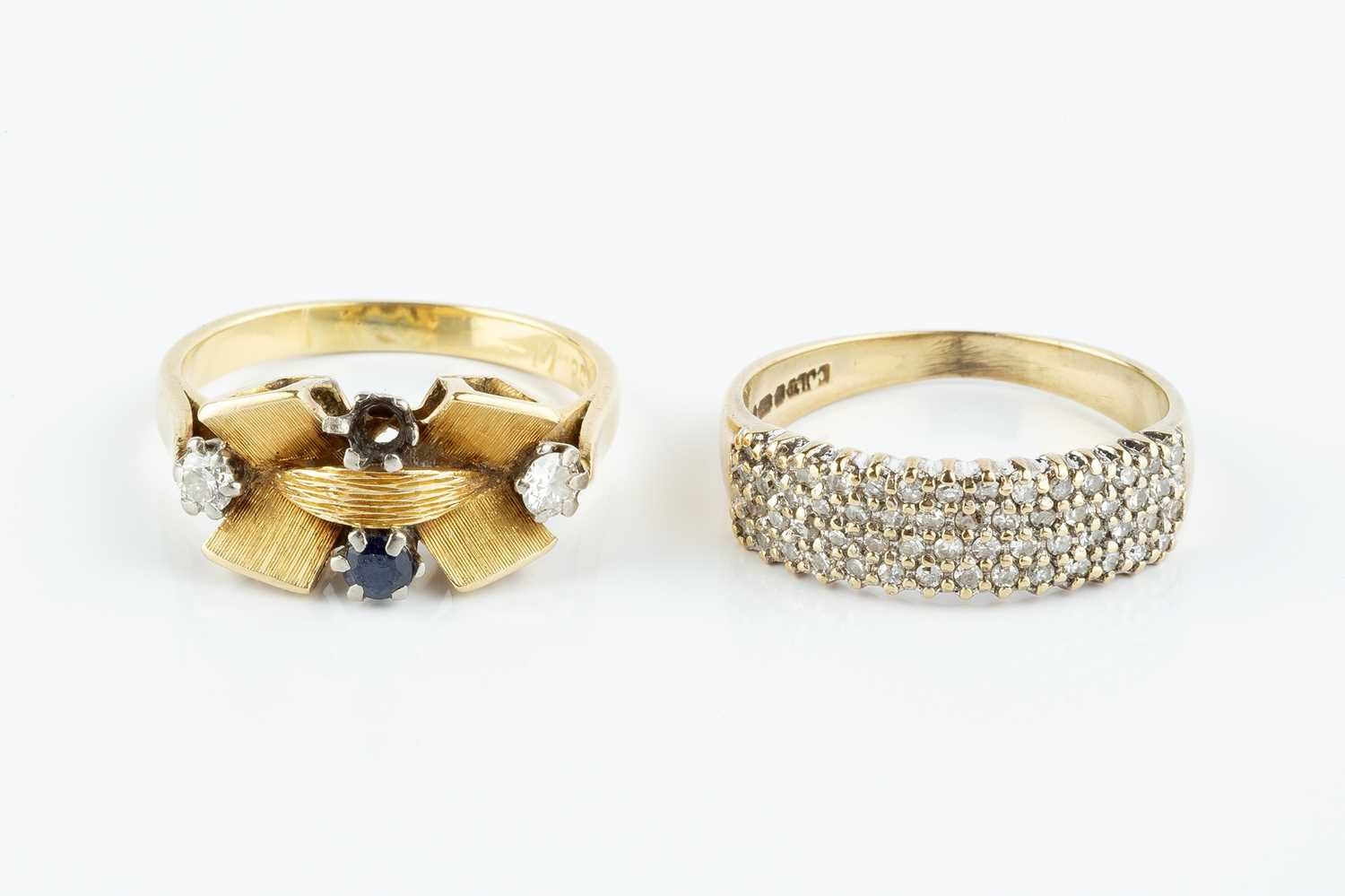 A sapphire and diamond dress ring, highlighted with a circular mixed-cut sapphire and two round