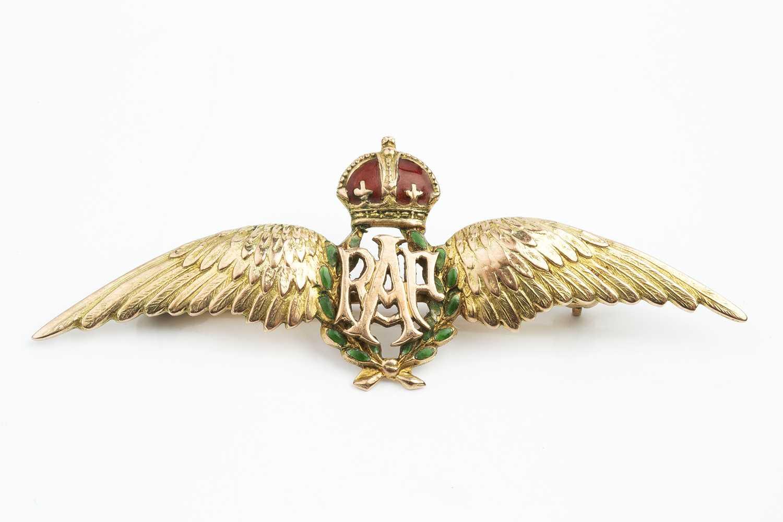 An enamel RAF wings brooch, with green enamel wreath and red enamel coronet, stamped '9ct', length