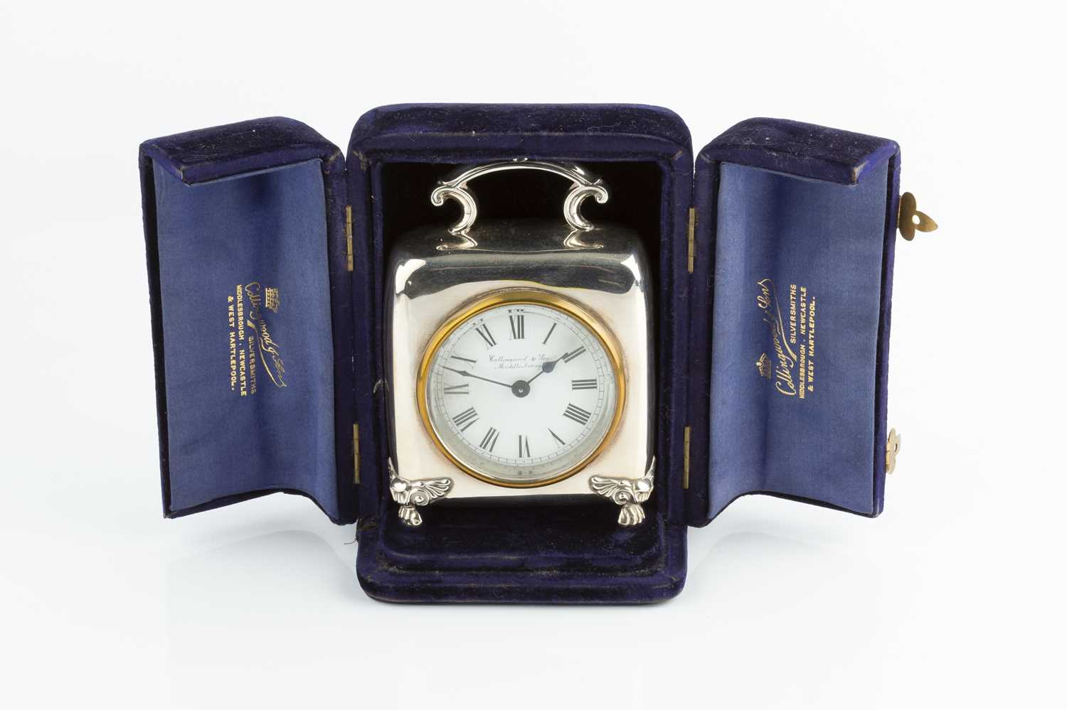 An Edwardian silver cased mantel timepiece, of rounded square design, with scroll handle, and