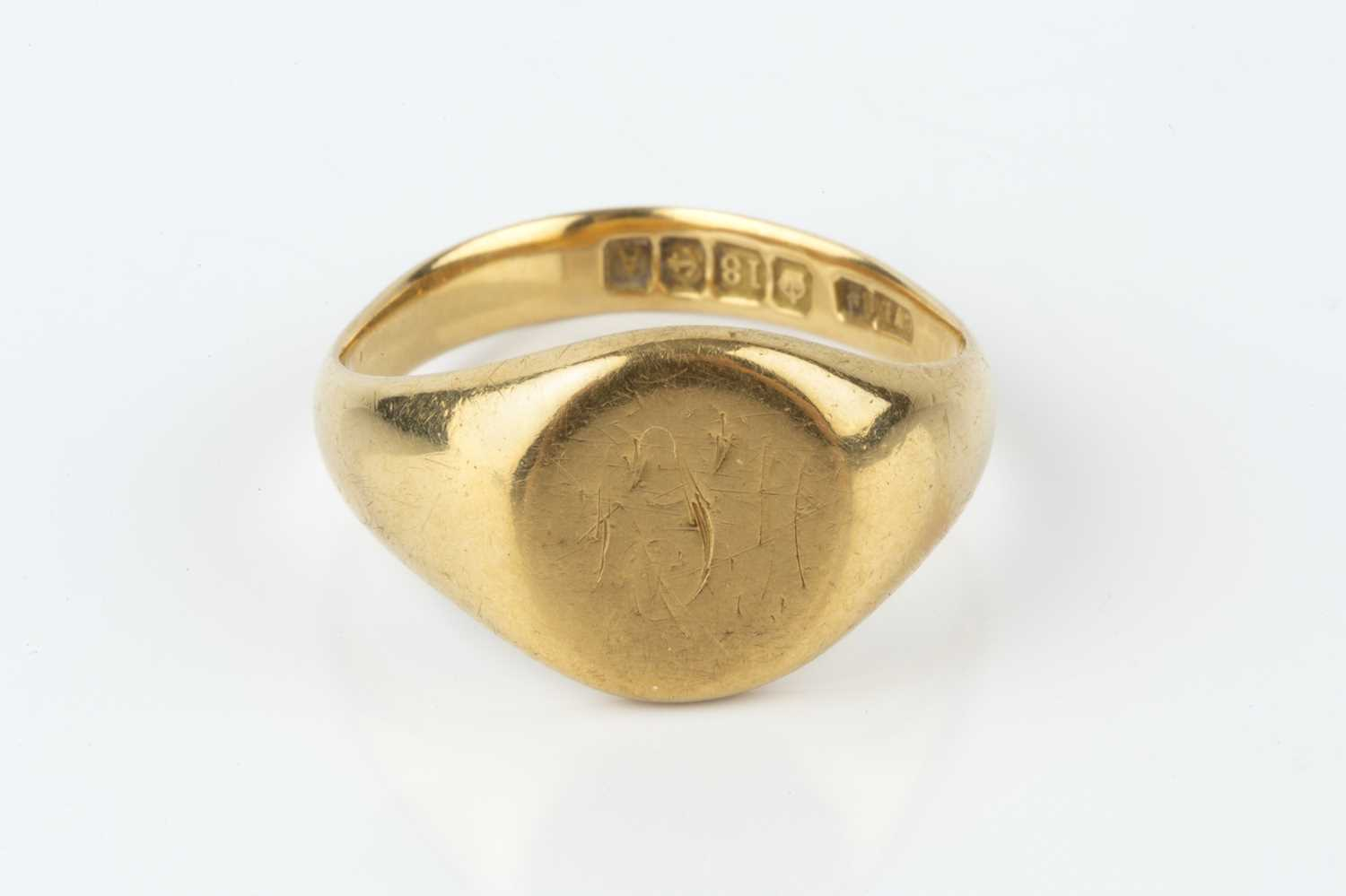 An 18ct gold signet ring, hallmarked for Birmingham 1925, monogrammed, ring size approximately