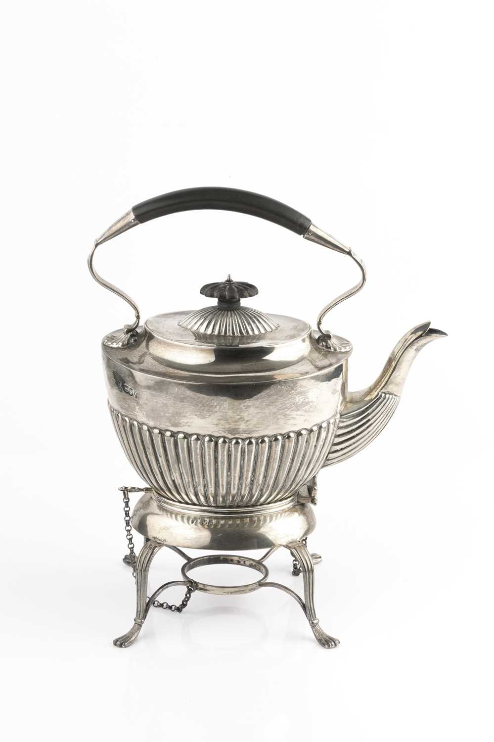 A late Victorian silver tea kettle on stand, with half lobed decoration, having ebonised fixed